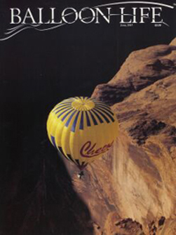 Cheers over Glenn Canyon, AZ  Balloon Life cover photo by Ron Behrmann